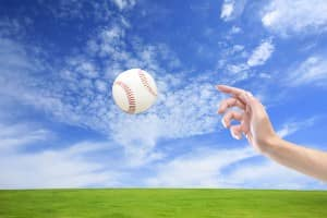 This is a picture of a hand throwing a baseball.
