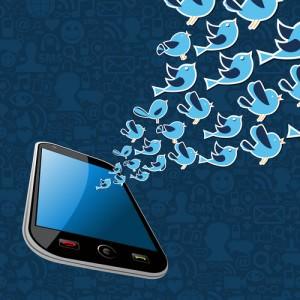 Twitter birds splash out of smartphone.