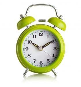old-fashioned alarm-clock on white background
