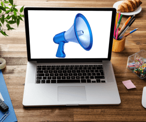 A laptop with a megaphone on it.