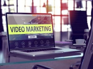 Image of a laptop with the words video marketing on the screen.