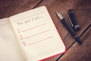 50056574 - new year resolution, empty list. on wooden table