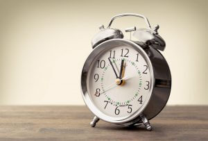 An alarm clock on a table.