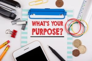 Whats your purpose. office desk with stationery and mobile phone.