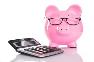 Piggy bank and calculator isolated on white background