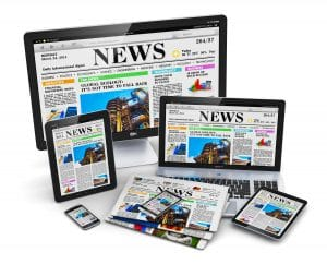 A variety of devices with screens all showing a newspaper to symbolize successful public relations strategy