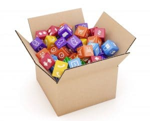 A cardboard box of full of cubes with marketing symbols on them