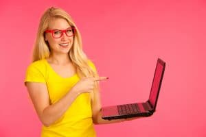 Beautiful young woman holds a laptop