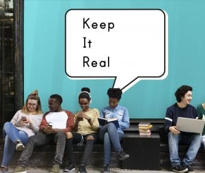"""Kids sitting on a bench under a """"keep it real"""" sign showing what authentic social media branding is."""