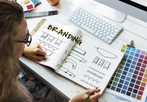 Woman looking a logo designs for branding on social media.