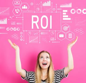 Woman looking up and smiling at ROI graphics above her.