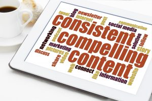 consistent, compelling content - a word cloud on a digital tablet