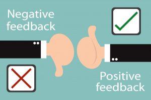 Cartoon hands signaling positive and negative feedback.