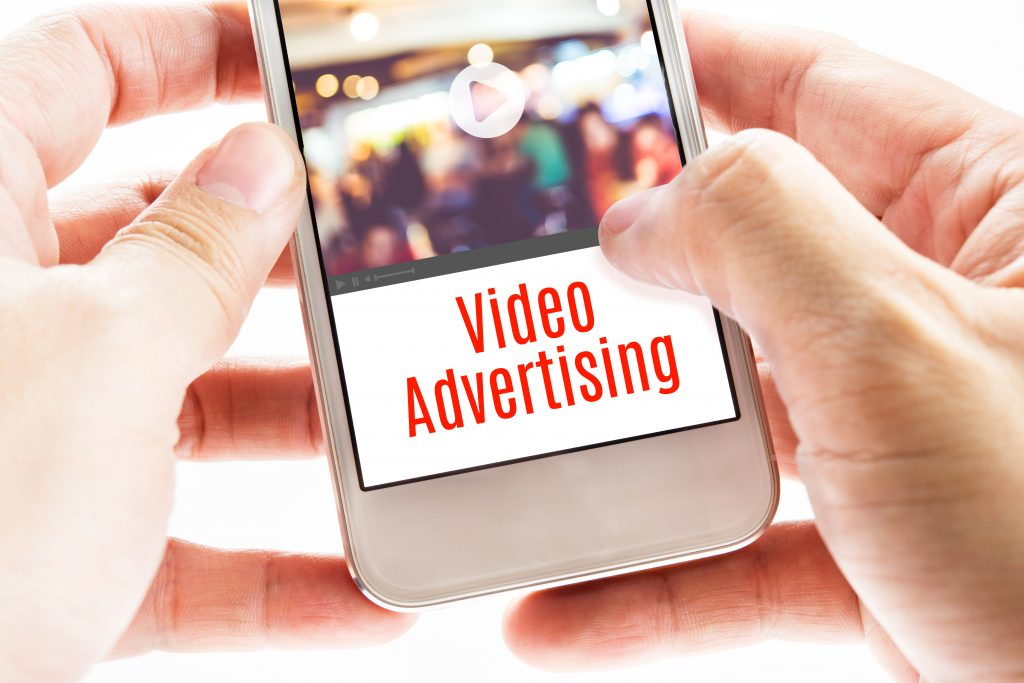 Two hands holding a iPhone with the words video advertising