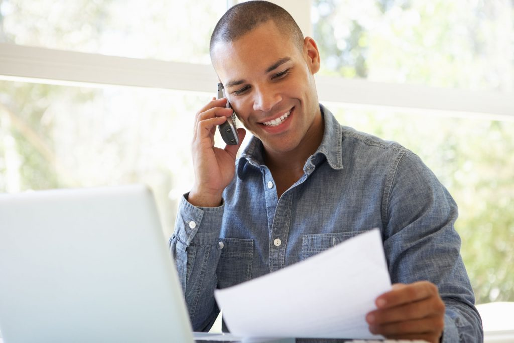 Man answering social media crisis with customer service.