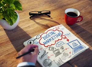 The words ' digital marketing' surrounded by keywords and pictures