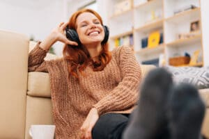 Woman happily listening to podcast