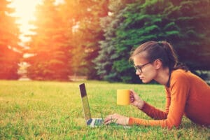 Female sitting outside working on content creation