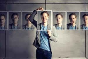 Man with photos showing different personalities for content marketing